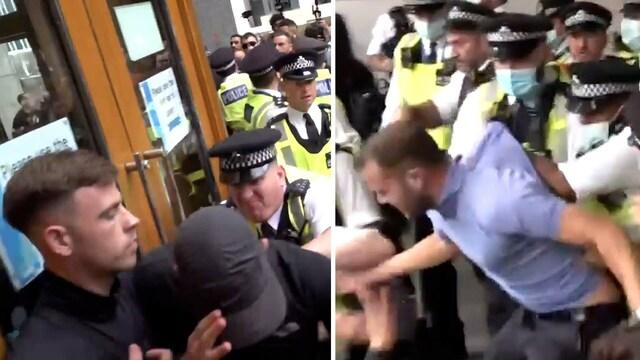 Uutisklipit, Rokotevastustajat yrittivät murtautua terveysvirastoon Lontoossa – videolle tallentunut tilanne kärjistyi poliisin ja aggressiivisen joukon käsirysyksi